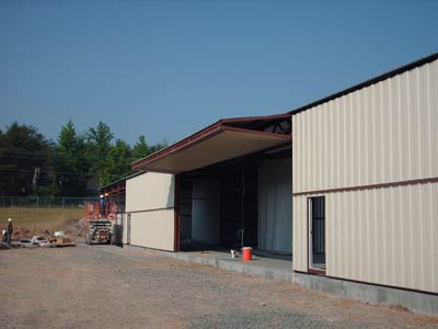 two Erect-a-Tube buildings that containing 8 nested T-Hangars each - Rockingham County Airport